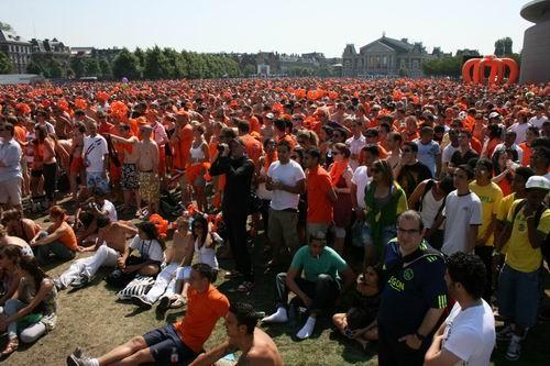 Tens of thousands watch the match.