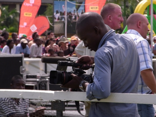 derrick filming the goat race in Kampala 2010