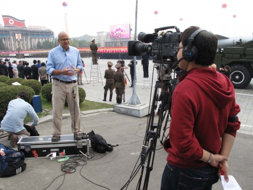 AP GMS operates a live camera for CCTV English News in Kim Il Sung Square, Pyongyang during a Military Parade to mark the 65th Anniversary of the foundation of the Workers Party of Korea.