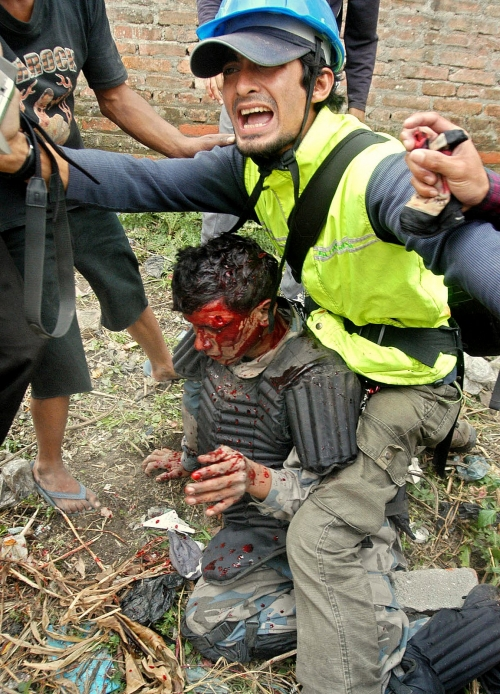 Saving a policeman's life. Wrong or Right ? While Covering a battle of Gangabu in Kathmandu during People's Movement against former king.
