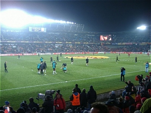 Arsenal players on the pitch preparing for the match
