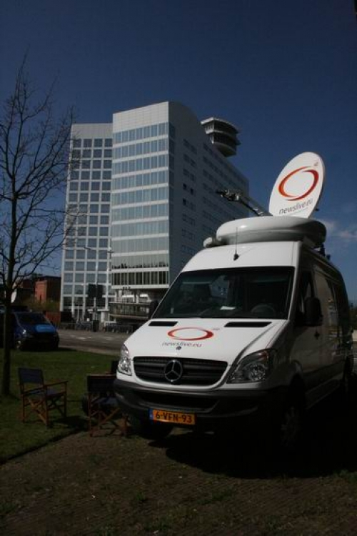 SNG truck in front of the ICC