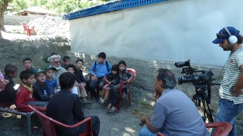 Faridoun Hemani interviewing Mr Rahmat Ghafoor Baig and kids, some of whom are traumatized from the floods of 2010