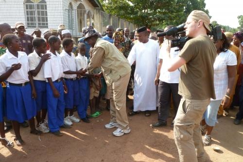 Kandeh K. Yumkella, Director-General of UNIDO greeting local school children