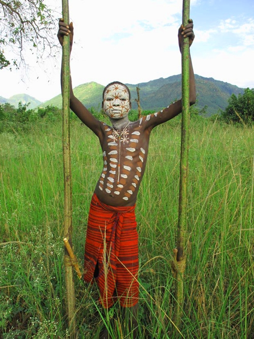 Surma Boy ( with stilts ) from Ethiopia
