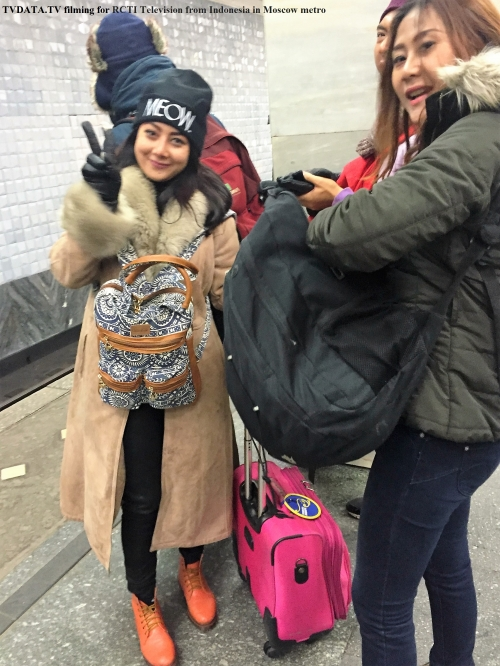 Filming in Russia- In Moscow Metro.  Filming' Amazing race' show for RCTI Television from Indonesia. TV show contestants embarking on the metro train followed by several cameramen. They are supposed to find their way in Moscow metro of 12 lines and 195 stations.