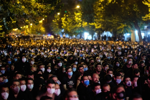 Iranian Shi'ite mourners who do not observing social distancing wearing protective face masks while attending a Muharram mourning ceremony in southern Tehran on August 28, 2020.